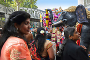 Garlanded model elephant on a float at the parade celebrating the festival of Ganesh Chaturthi, marking the birth of the Hindu god Ganesha, on the streets of the La Chapelle area of the 18th arrondissement of Paris, France, on Sunday 1st September 2019. The annual religious festivities and parade take place near the Ganesha Temple of Paris, or Sri Manicka Vinayakar Alayam Temple, the largest Hindu temple in France. Ganesha is the elephant-headed Hindu God of Beginnings, son of Shiva and Parvati, who represents love and knowledge. Picture by Manuel Cohen