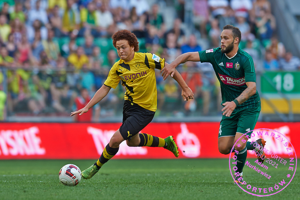 (L) Mustafa Amini of Borussia Dortmund controls the ball during international friendly soccer match between WKS Slask Wroclaw and BVB Borussia Dortmund on Municipal Stadium in Wroclaw, Poland.<br /> <br /> Poland, Wroclaw, August 6, 2014<br /> <br /> Picture also available in RAW (NEF) or TIFF format on special request.<br /> <br /> For editorial use only. Any commercial or promotional use requires permission.<br /> <br /> Mandatory credit:<br /> Photo by &copy; Adam Nurkiewicz / Mediasport
