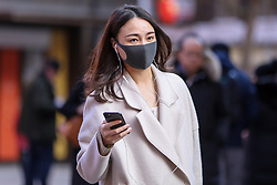 © Licensed to London News Pictures. 01/03/2020. London, UK. An Asian woman wearing a fashionable face mask in Chinatown as a precaution against new type coronavirus (COVID-19). Twelve more people have tested positive for coronavirus in the UK, bringing the total number of cases to 35. Photo credit: Dinendra Haria/LNP