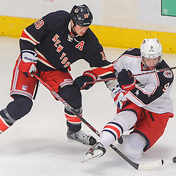 New York Rangers defenseman Marc Staal (18) shoves Columbus Blue Jackets left wing Colton Gillies (9) off the puck and to the ice during second period NHL action between the Columbus Blue Jackets and the New York Rangers at Madison Square Garden in New York, N.Y.