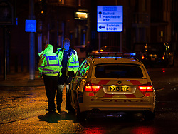 © Licensed to London News Pictures . 20 December 2013 . Manchester , UK . Scene of a road traffic accident in Patricroft in Salford where a woman and a car collided . A Mad Friday shift with Inspector Matt Bailey-Smith , of Greater Manchester Police's ANPR and Tactical Vehicle Intercept Unit . Photo credit : Joel Goodman/LNP