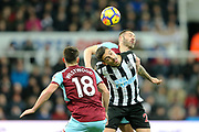 Ashley Westwood (#18) of Burnley watches as Joselu (#21) of Newcastle United flicks the ball on from a throw in during the Premier League match between Newcastle United and Burnley at St. James's Park, Newcastle, England on 31 January 2018. Photo by Craig Doyle.