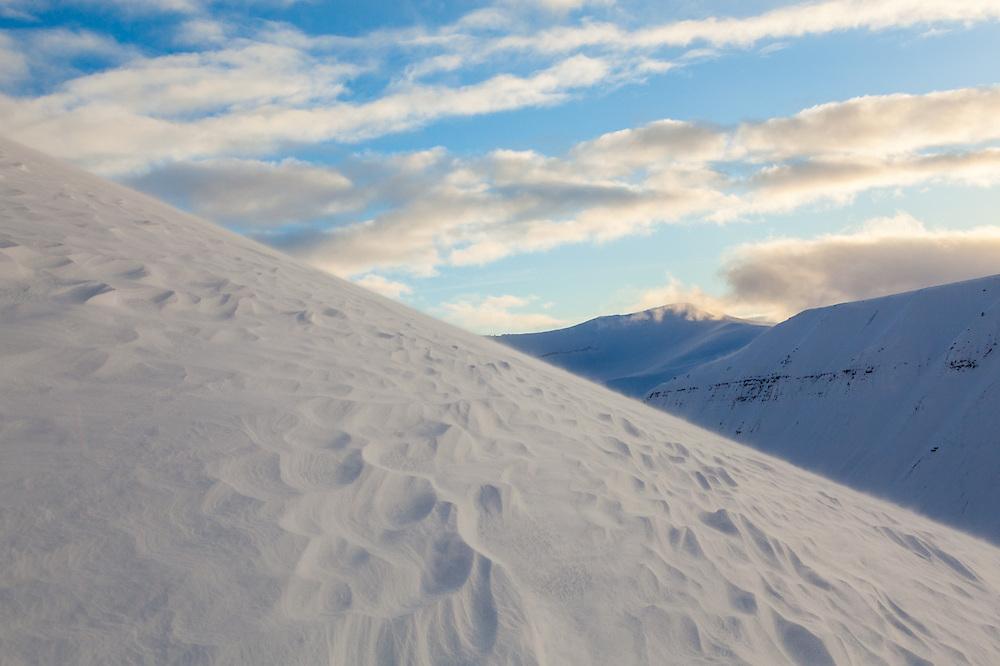 Snow waves at sunset on Hallwylfjellet, Svalbard.