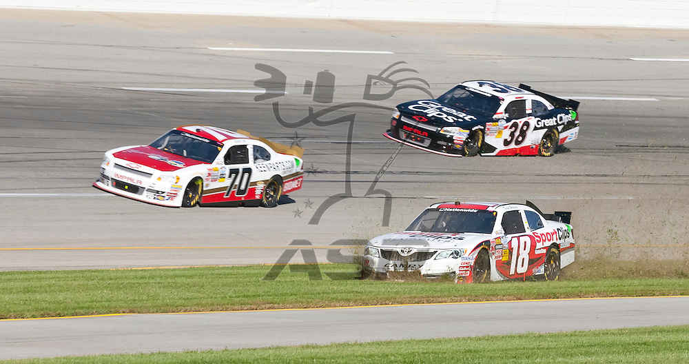 SPARTA, KY - SEP 22, 2012:  Drew Herring (18) crashes off turn 4 during the Kentucky 300 at the Kentucky Speedway in Sparta, KY.