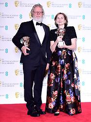 Tony McNamara and Deborah Davis with their Best Original Screenplay Bafta for The Favourite in the press room at the 72nd British Academy Film Awards held at the Royal Albert Hall, Kensington Gore, Kensington, London.
