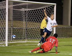 Virginia Cavaliers F Yannick Reyering (11) reacts after scoring his second goal of the game to put Virginia up 2-0.  The Virginia Cavaliers men's soccer team faced the Liberty Flames  in at Klockner Stadium in Charlottesville, VA on October 23, 2007.