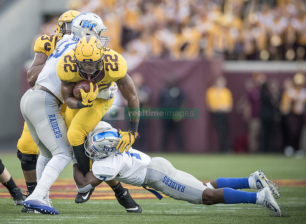 September 16, 2017 - Minneapolis, MN, USA - Minnesota running back Kobe McCrary (22) picks up yardage as Middle Tennessee safety Jovante Moffatt makes the tackle during the third quarter at TCF Bank Stadium, Saturday, Sept. 16, 2017, in Minneapolis. The host Gophers won, 34-3. (Credit Image: © Elizabeth Flores/TNS via ZUMA Wire)