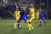 AFC Wimbledon striker Tom Elliott (9) taking on two Sutton players during the The FA Cup third round replay match between AFC Wimbledon and Sutton United at the Cherry Red Records Stadium, Kingston, England on 17 January 2017. Photo by Matthew Redman.