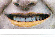 extreme mouth close up from a newspaper or magazine style print with halftone print dots