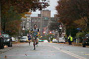 Dan Serianni of Rochester runs the homestretch at the East Ave Grocery Run in Rochester on Saturday, November 1, 2014. Serianni finished fourth in 16:23.4.