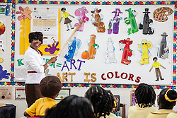 Art teacher and department chair, Ms. Linda D. Freeman, instructs her 4th grade students on the First Day of School at Joseph A. Gomez Elementary School. 4 September 2012.  © Aisha-Zakiya Boyd