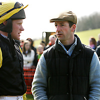 Gold Cup winner on Best Mate Jim Culloty speaking with jockey C.J Sweeney before the first race at the Dromoland Point to Point on Sunday.<br />