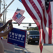 President Trump supporters wave flags and signs as his motorcade goes by them. Trump arrived for his third weekend in a row to his winter White House Mar-a-Lago in Palm Beach.<br /> Photography by Jose More