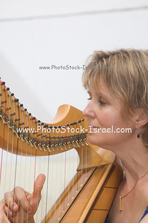A woman playing a Celtic harp Jacob's Ladder Festival, Israel May 2005