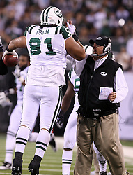 Sept 13, 2011; East Rutherford, NJ, USA; New York Jets defensive tackle Sione Pouha (91) celebrates his fumble recovery with head coach Rex Ryan during the first half at the New Meadowlands Stadium.
