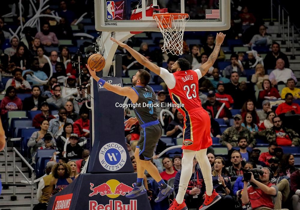 Dec 5, 2018; New Orleans, LA, USA; Dallas Mavericks guard J.J. Barea (5) shoots over New Orleans Pelicans forward Anthony Davis (23) during the second half at the Smoothie King Center. Mandatory Credit: Derick E. Hingle-USA TODAY Sports