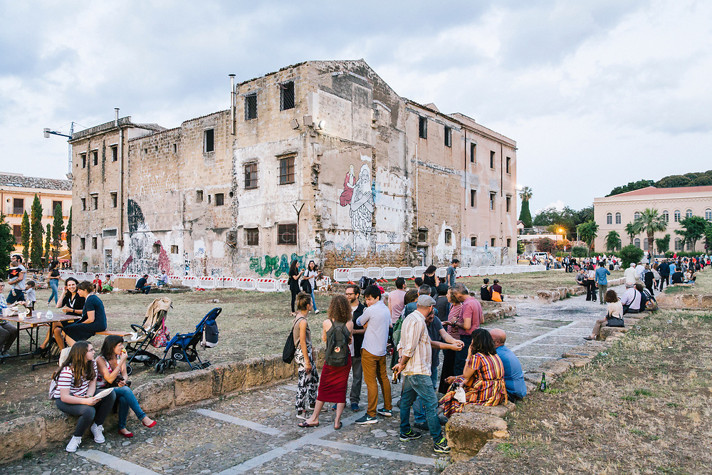 PALERMO, ITALY - 16 JUNE 2018: Vistors of  Manifesta 12, the European nomadic art biennal, are seen here in Piazza Magione during the inauguration in Palermo, Italy, on June 16th 2018.<br /> <br /> Manifesta is the European Nomadic Biennial, held in a different host city every two years. It is a major international art event, attracting visitors from all over the world. Manifesta was founded in Amsterdam in the early 1990s as a European biennial of contemporary art striving to enhance artistic and cultural exchanges after the end of Cold War. In the next decade, Manifesta will focus on evolving from an art exhibition into an interdisciplinary platform for social change, introducing holistic urban research and legacy-oriented programming as the core of its model.<br /> Manifesta is still run by its original founder, Dutch historian Hedwig Fijen, and managed by a permanent team of international specialists.<br /> <br /> The City of Palermo was important for Manifesta&rsquo;s selection board for its representation of two important themes that identify contemporary Europe: migration and climate change and how these issues impact our cities.