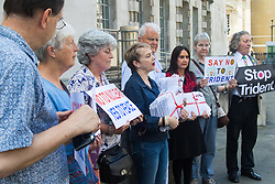 Ministry of Defence, Westminster, July 18th 2016. A petition with over 40,000 signatures is handed in to the Ministry of Defence, calling for the abandonment of the Trident Nuclear deterrent programme ahead of a debate on the issue in Parliament. PICTURED: Kate Hudson from CND, fourth from left, Kent Bruce from CND and SNP MP Margaret Ferrier outside the Ministry of Defence with supporters from CND prior to delivering the petition.