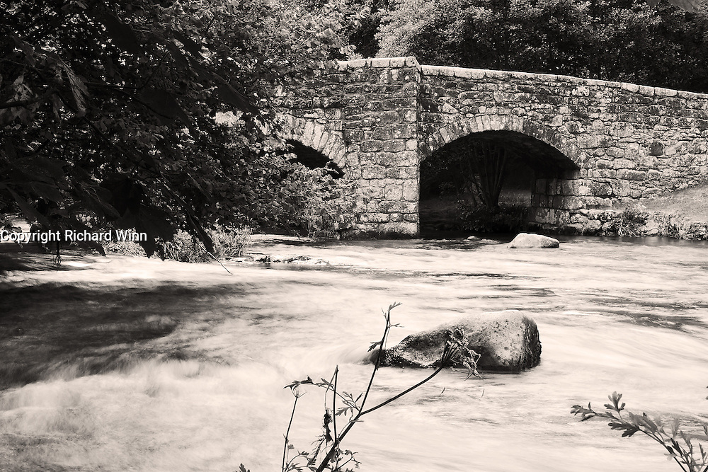 View of Fingle Bridge, on the edge of Dartmoor, in Devon, UK. Most photographs of the bridge are taken from the other bank, but the amount of people in the pub garden forced me to try a different angle, which added some originality.