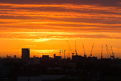 Primrose Hill, London, September 27th 2016. Distant tower cranes break the skyline, viewed from Primrose Hill as dawn breaks over London. ©Paul Davey<br /> FOR LICENCING CONTACT: Paul Davey +44 (0) 7966 016 296 paul@pauldaveycreative.co.uk