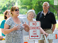 Lori Clappier (L) speaks about the road closure on Matthews Road as she stands with some of her neighbors Tuesday May 26, 2015 in New Britain, Pennsylvania. (Photo by William Thomas Cain/Cain Images)