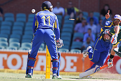 © Licensed to London News Pictures. 08/03/2012. Adelaide Oval, Australia. Sri Lankan fielder Tillakaratne Dilshan raises his finger after getting a direct hit run out to remove Michael Hussey during the One Day International cricket match final between Australia Vs Sri Lanka. Photo credit : Asanka Brendon Ratnayake/LNP