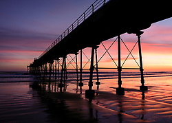 © Licensed to London News Pictures. <br /> 26/03/20167. <br /> Saltburn by the Sea, UK.  <br /> <br /> A spectacular sunrise starts the day over the pier in Saltburn by the Sea.<br /> <br /> Photo credit: Ian Forsyth/LNP