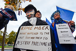 © Licensed to London News Pictures. 05/11/2019. LONDON, UK.  Remain supporters, with an effigy of Guy Fawkes, protest outside the Houses of Parliament.  Inside, MPs are making their final statements on the day before Parliament is dissolved ahead of the General Election on 12 December, where each parties stance on Brexit will have a significant affect on the voting.  Photo credit: Stephen Chung/LNP