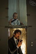 What do you do when you have a lot of cardboard boxes left over from a move and a baby that needs to be kept busy?<br /> <br /> Passionate cinephiles Leon Mackie and his wife, Lilly Lang, solved the problem by launching the Cardboard Box office project where they recreate famous scenes from their favorite films using packing materials for the entertainment of their son, Orson. <br /> On their site, Cardboardboxoffice.com, the couple, who live in Australia, explained that they decided to turn their home into an amateur film studio after moving.<br /> <br /> In October, Mackie, a book designer, transplanted his family from Melbourne to Sydney to take a job with a book publisher. <br /> 'With our social lives drastically altered we decided to find a way to make some of those housebound weekends a little more fun,' the couple wrote on their site.<br /> For the past month, Leon, Lilly and their 10-month-old son, Orson, have been busy building movie sets out of household items and re-enacting scenes from films like Apollo 13, The Dark Knight (in their version, The Dark Knighty-Night), Indiana Jones: The Temple of Doom (The Cradle of Doom), and many others. <br /> The family so far have accumulated more than a dozen hilarious photos showcasing their unbridled creativity and acting chops, with amusing, child-friendly titles to boot.<br /> Their latest pre-Christmas offering posted this week on their site and labelled  Homemade Alone is inspired by the 1990 holiday classic Home Alone. 