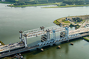 Nederland, Zuid-Holland, Rotterdam, 28-09-2014; Botlekbrug, bouw van de nieuwe gecombineerde spoor- en autowegbrug over de Oude Maas. De nieuwe brug wordt gebouwd door Ballast Nedam naast de bestaande hefbrug.<br /> Botlekbrug, construction of the new combined rail and road bridge over the Oude Maas. The new bridge will be built alongside the existing lift bridge.<br /> luchtfoto (toeslag op standard tarieven);<br /> aerial photo (additional fee required);<br /> copyright foto/photo Siebe Swart.