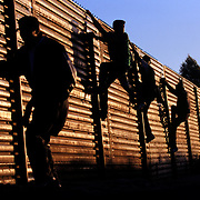 Undocumented migrants flee back toward Mexico after being chased by the U.S. Border Patrol along the U.S.-Mexico border in San Diego, California. <br /> <br /> Photo registered with the US Copyright Office. &copy; Todd Bigelow<br /> <br /> Please contact Todd Bigelow directly with your licensing requests. <br /> <br /> PLEASE CONTACT TODD BIGELOW DIRECTLY WITH YOUR LICENSING REQUEST. THANK YOU!