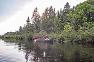 Brule River fishing guide Damian Wilmot (left) paddles the Upper Brule near Lake Nebagamon, Wisconsin, with angler Matson Holbrook in a 1895 Joe Lucius guide canoe Wilmot meticulously restored over the course of two years.