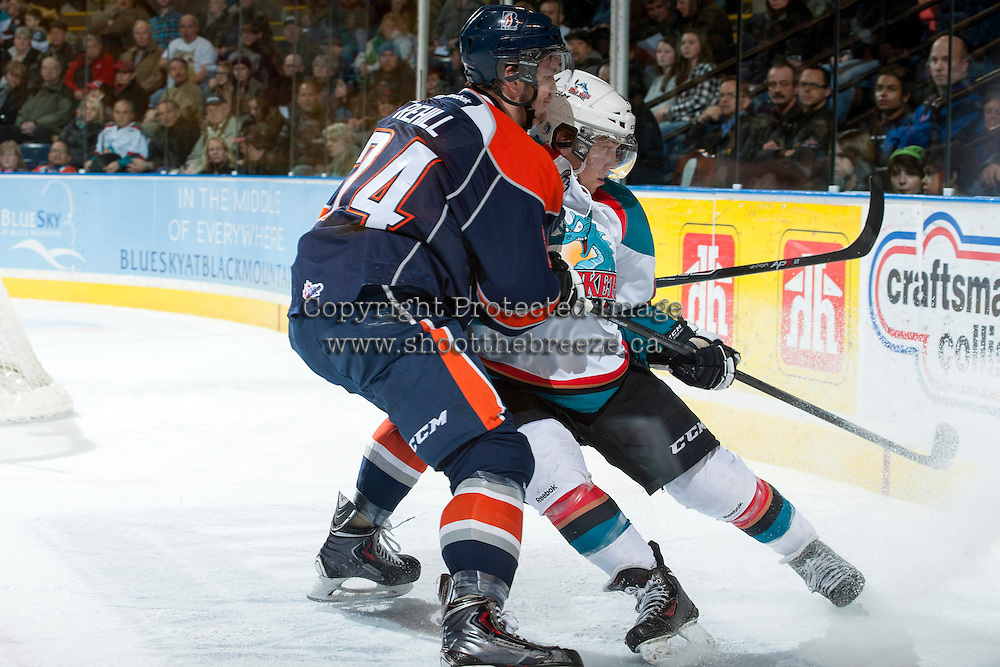 KELOWNA, CANADA -FEBRUARY 1: Ryan Rehill D #24 of the Kamloops Blazers checks Rourke Chartier #14 of the Kelowna Rockets at the boards on February 1, 2014 at Prospera Place in Kelowna, British Columbia, Canada.   (Photo by Marissa Baecker/Getty Images)  *** Local Caption *** Ryan Rehill; Rourke Chartier;