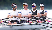 Members of the Canadian Olympic mens rowing quad (left to right) Pascal Lussier, Will Dean, Rob Gibson and Julien Bahain scull during a morning training session on Elk Lake in Victoria, British Columbia on June 22, 2016.