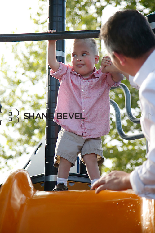 5/28/15 6:06:21 PM -- Miracle Miles and his family pose for portraits and play at the QuikTrip park for the 2015 Saint Francis Health System advertising campaign. <br /> <br /> Photo by Shane Bevel
