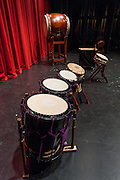 Taiko drums lined up on stage prior to Portland Taiko's 2012 concert Making Waves, Portland State University Lincoln Performance Hall, Portland, Oregon