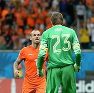 Tim Krul of Netherlands celebrates with Wesley Sneijder after saving a penalty to win the 2014 FIFA World Cup match against Costa Rica at the Itaipava Arena Fonte Nova, Nazare, Bahia<br /> Picture by Stefano Gnech/Focus Images Ltd +39 333 1641678<br /> 05/07/2014