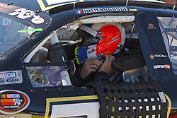ROSEVILLE, CA - OCTOBER 13: Julien Jousse, driver of the #73 Barbarac Ice Cream Chevrolet adjusts his helmet during practice for the NASCAR K&N Pro Series West Toyota/NAPA 150 at the All American Speedway on October 13, 2012 in Roseville, California. (Photo by Jason O. Watson/Getty Images for NASCAR) *** Local Caption *** Julien Jousse