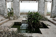 The sunken bed in the master bedroom of the Eagle's Nest Palace, one of three extravagant residences built by the former ruler of Zaire Mobutu Sese Seko in and around his native village of Gbadolite in Equateur province. The town and properties were looted by rebel forces during the country's civil war..Kawele, DR Congo. 18/03/2009..Photo © J.B. Russell