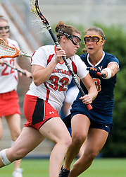 Maryland Terrapins Attack Lauren Cohen (32) is defended by Virginia Cavaliers D Jen Holden (8).  The #3 ranked Virginia Cavaliers defeated the #2 ranked Maryland Terrapins 10-9 in overtime in the finals of the Women's 2008 Atlantic Coast Conference Lacrosse tournament at the University of Virginia's Scott Stadium in Charlottesville, VA on April 27, 2008.