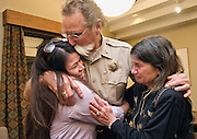 """Teton County Sheriff Bob Zimmer hugs Maria Vargas, left, and Suzie Kirvinskee just after announcing his retirement on Monday night in a closed door meeting at the county commissioners chambers. """"It's been a great life, what a life I've had,"""" Zimmer said. The sheriff plans on spending more time with his parents in Arizona after he leaves office on Jan. 6. """"That's my calling today."""""""