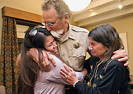 "Teton County Sheriff Bob Zimmer hugs Maria Vargas, left, and Suzie Kirvinskee just after announcing his retirement on Monday night in a closed door meeting at the county commissioners chambers. ""It's been a great life, what a life I've had,"" Zimmer said. The sheriff plans on spending more time with his parents in Arizona after he leaves office on Jan. 6. ""That's my calling today."""