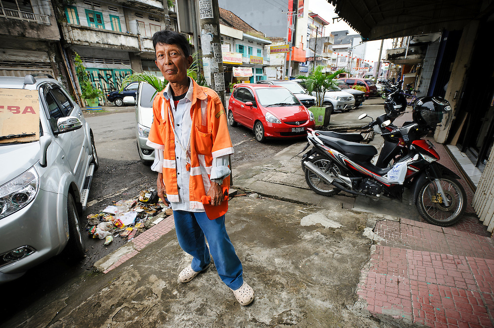 Bapak Lahakim working on Jalan Sulawesi, Makassar, Sulawesi, Indonesia. Bapak Lahakim, 52, is originally from Baru, Sulawesi, but moved to Jongaya in 1968 at the age of 10.  He has worked as a parking attendant on Jalan Sulawesi, Makassar, since 1990.