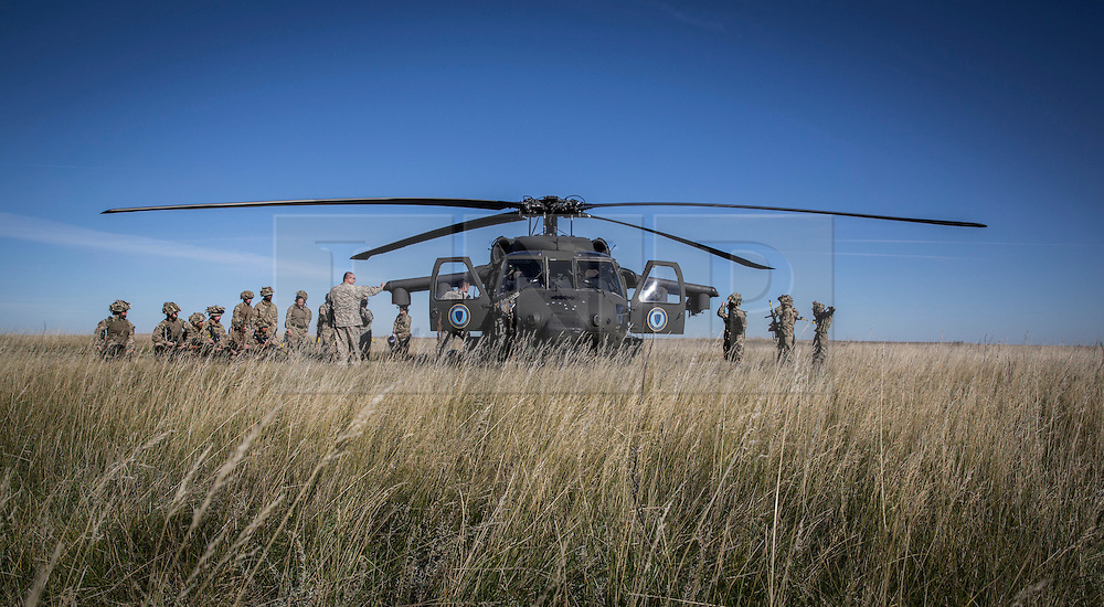 © Licensed to London News Pictures. 08/10/2014.  British Army Training Unit Suffield (BATUS), Canada. Soldiers are introduced and trained on a Blackhawk helicopter as they prepare for Exercise Prairie Storm 3 in Canada.   <br /> <br /> BATUS has been home to the Army for the past 42 years .  It is the only place where all elements of the British Army train together for war.  The soldiers are put to test on everything from armoured vehicles to infantry tactics.        Photo credit : Alison Baskerville/LNP
