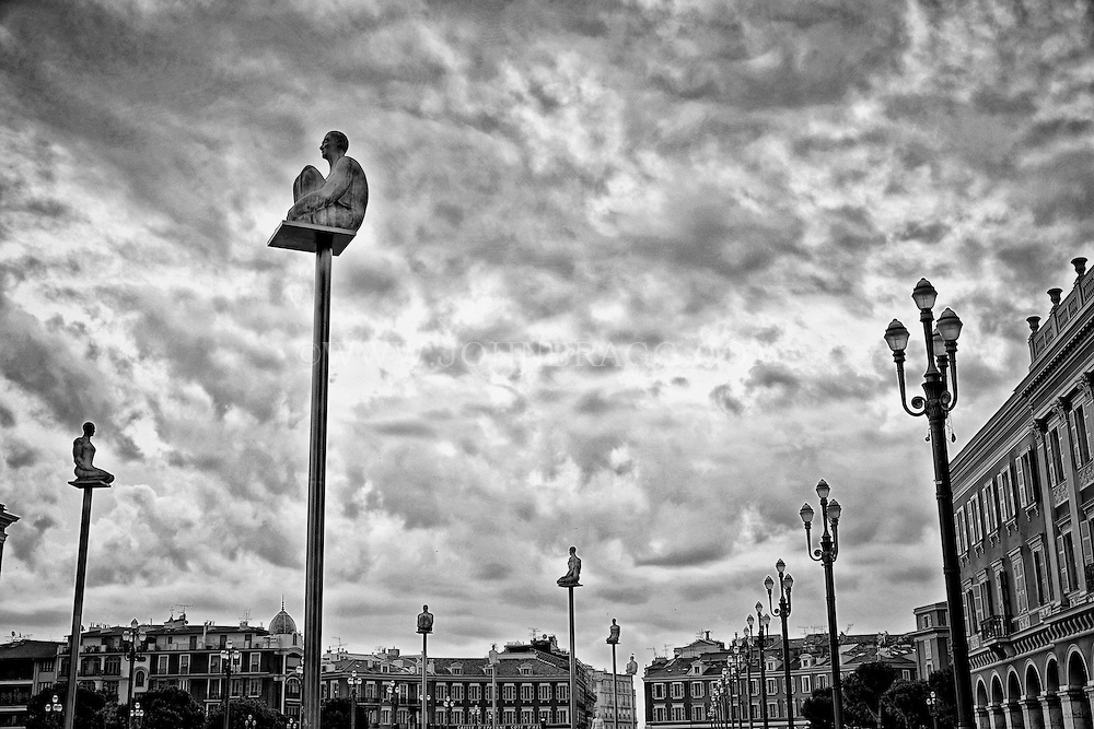 Black and white view of the Seven Statues of The Massena Place, Nice, France.