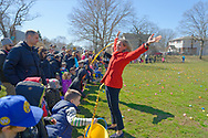 North Merrick, New York, USA. March 31, 2018. Nassau County Executive LAURA CURRAN flings her arms up high after cutting the yellow tape to start the Egg Hunt at the Annual Eggstravaganza, held at Fraser Park and hosted by North and Central Merrick Civic Association (NCMCA) and Merrick's American Legion Auxiliary Unit 1282. Young children rush to collect eggs in their Easter baskets.