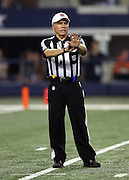 Referee Walt Anderson (66) calls a penalty during the Dallas Cowboys NFL week 6 football game against the Washington Redskins on Sunday, Oct. 13, 2013 in Arlington, Texas. The Cowboys won the game 31-16. ©Paul Anthony Spinelli