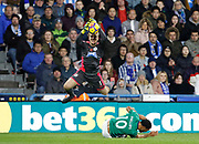 Huddersfield Town's Jonas Lössl catches under pressure from West Bromwich Albion's Matt Phillips during the Premier League match between Huddersfield Town and West Bromwich Albion at the John Smiths Stadium, Huddersfield, England on 4 November 2017. Photo by Paul Thompson.
