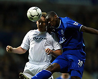 Photo. Aidan Ellis.<br />Bolton Wanderers v Everton.<br />FA Barclaycard Premiership.<br />29/11/2003.<br />Bolton's Kevin Davis and Everton's Joseph Yobo