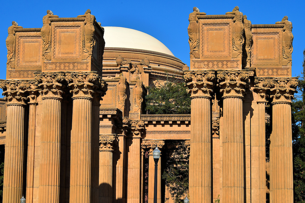 Palace of Fine Arts Weeping Women in San Francisco, California<br /> The entrance to the Palace of Fine Arts was originally built in 1915 to simulate ruins from ancient Roman or Greek architecture.  I was mesmerized by the tall colonnade leading to the main domed pergola.  The sculptures on these Corinthian columns, designed by Ulric Ellerhusen, are called the Weeping Women.